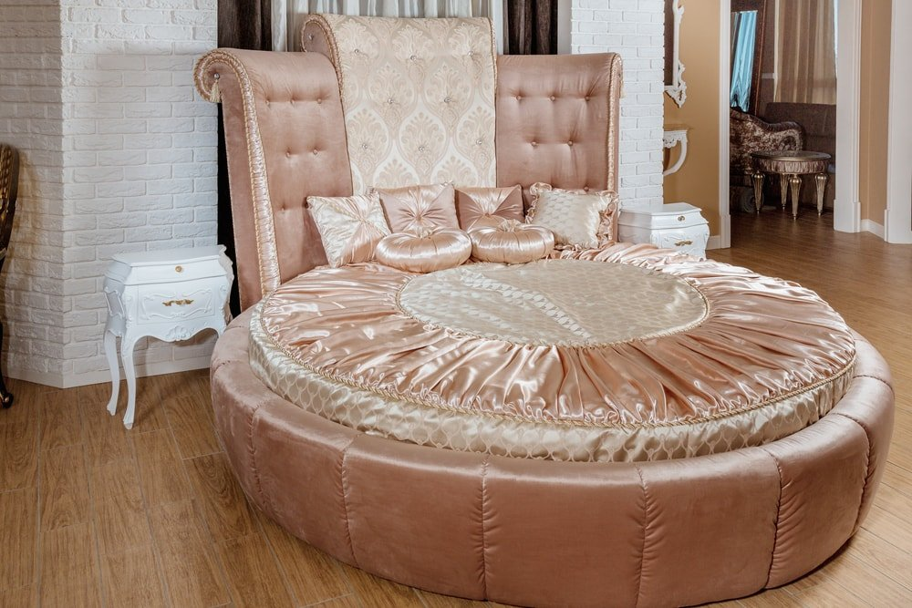 Neoclassical luxury round bed in pastel color.