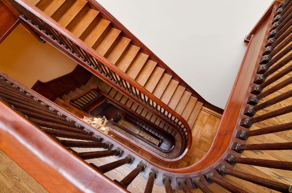 A look at the mansion's spiral staircase with hardwood steps and railings. Images courtesy of Toptenrealestatedeals.com.
