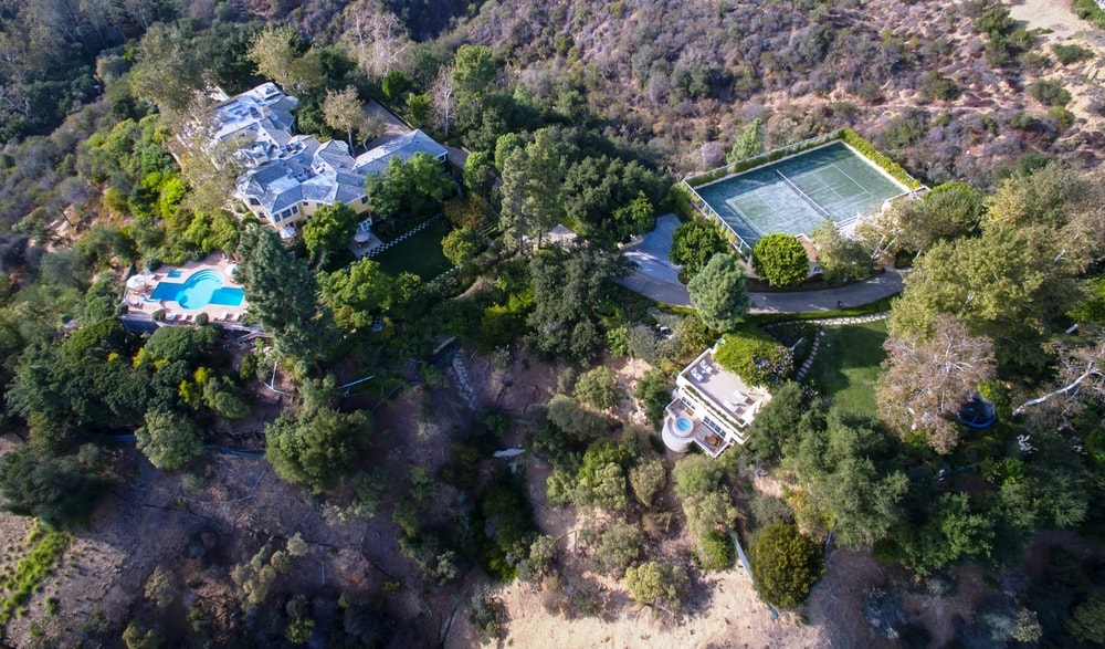 This aerial top view shows the proximity of the house to the different outdoor areas of the estate like the tennis court. Images courtesy of Toptenrealestatedeals.com.