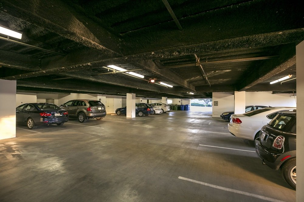 This is the large car garage that can fit a car collection on its wide and spacious concrete floor. Images courtesy of Toptenrealestatedeals.com.