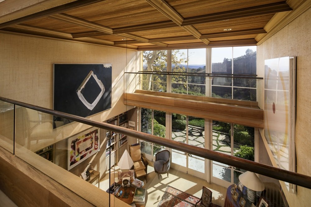 This is a close look at the indoor balcony above the library with glass railings to maximize the view of the tall glass wall. Images courtesy of Toptenrealestatedeals.com.