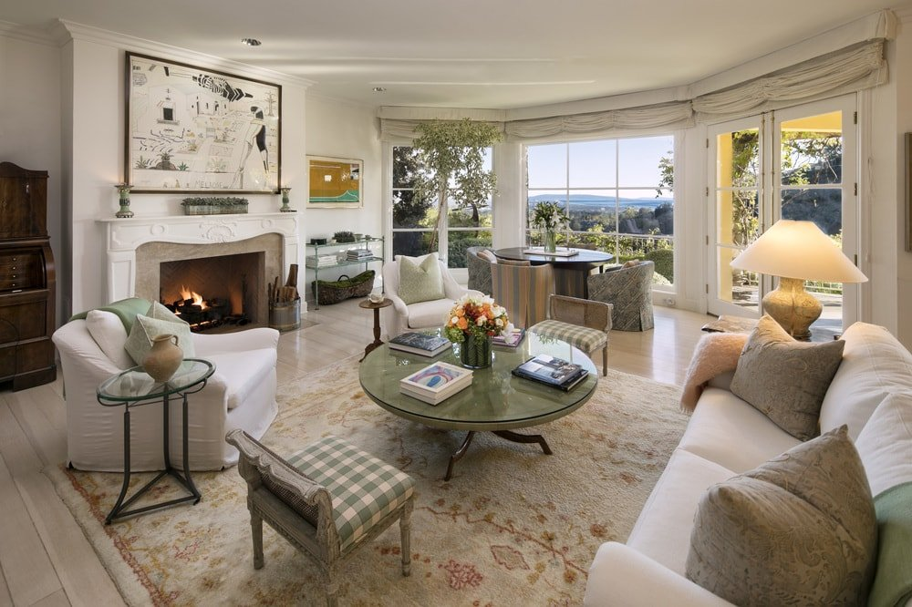 This is the lovely living room with beige walls, ceiling and sofa set complemented by the area rug and fireplace. There is also an informal dining area at the far end by the large window. Images courtesy of Toptenrealestatedeals.com.