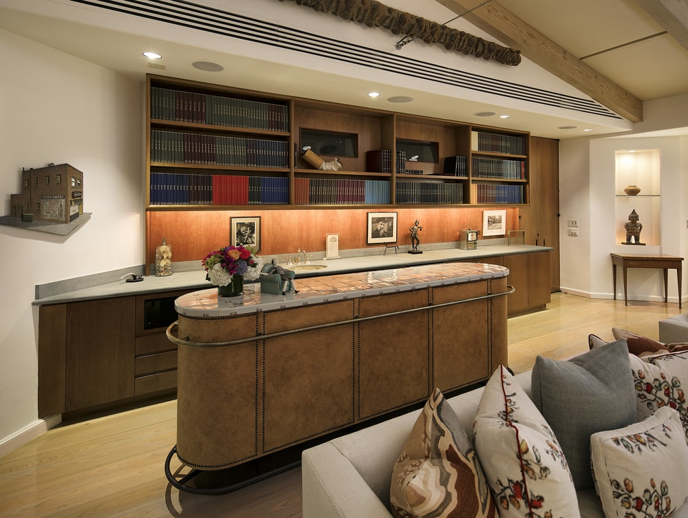 This is the wet bar of the estate with a lovely wooden counter and matching cabinetry topped with bookshelves. Images courtesy of Toptenrealestatedeals.com.