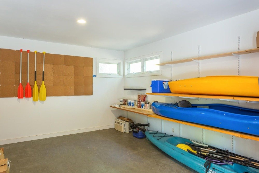 This room houses the boat equipment with some built-in shelving. Images courtesy of Toptenrealestatedeals.com.