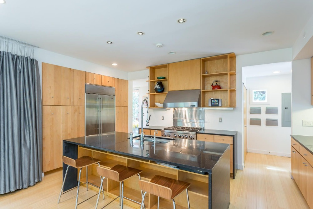 The kitchen's center island has built-in shelving and space for a breakfast bar. Images courtesy of Toptenrealestatedeals.com.