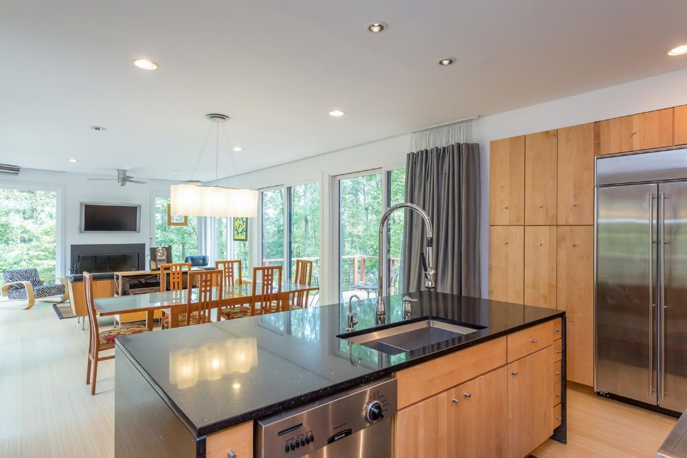 Another look at the kitchen's center island with a stylish black countertop. Images courtesy of Toptenrealestatedeals.com.