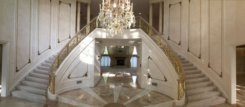 Grand foyer with a stunning double staircase surrounded by elegant walls and a soaring ceiling. Images courtesy of Toptenrealestatedeals.com.