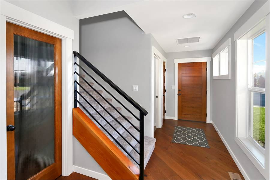 The opposite side consists of a carpeted staircase leading to the bonus room.
