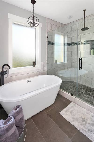 There's also a freestanding tub well-lit by a small spherical chandelier.