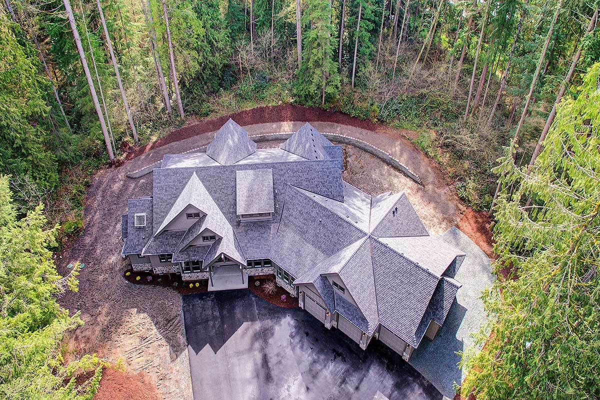 Aerial view showing the gable rooflines along with surrounding plants and trees.