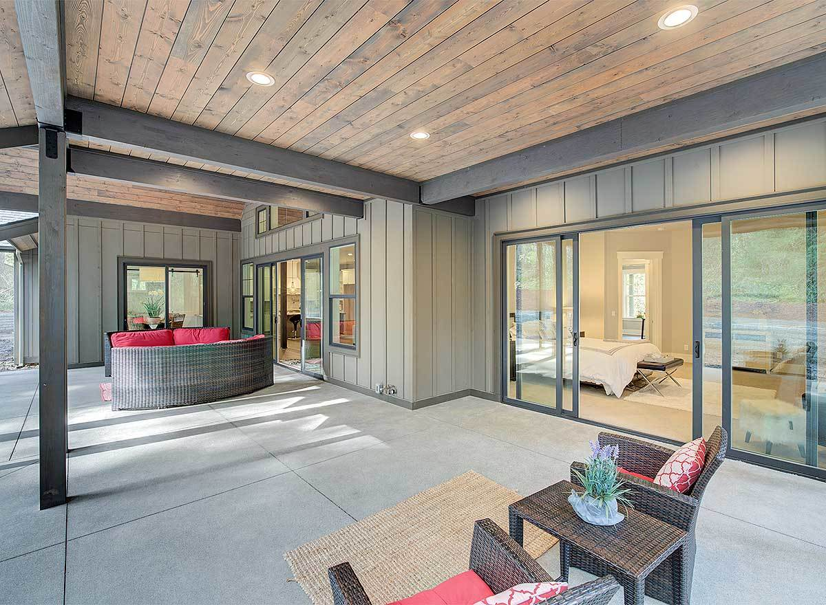 One last look at the outdoor spaces with wood plank ceiling supported by rustic columns.