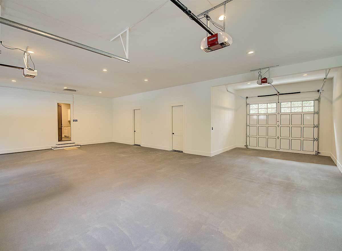 These two doors inside the garage lead to the exercise room and storage space.