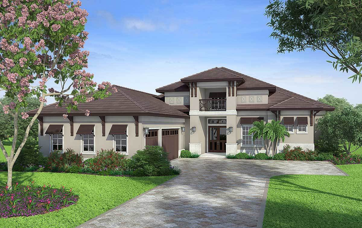Front exterior view with stucco siding, hipped roofs, and an enticing balcony sitting above the home's entry.