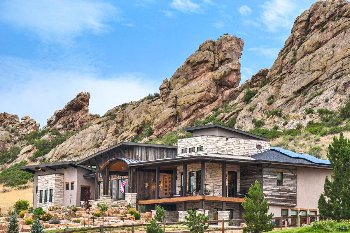 Stunning boulders create a magnificent backdrop to the modern mountain home.