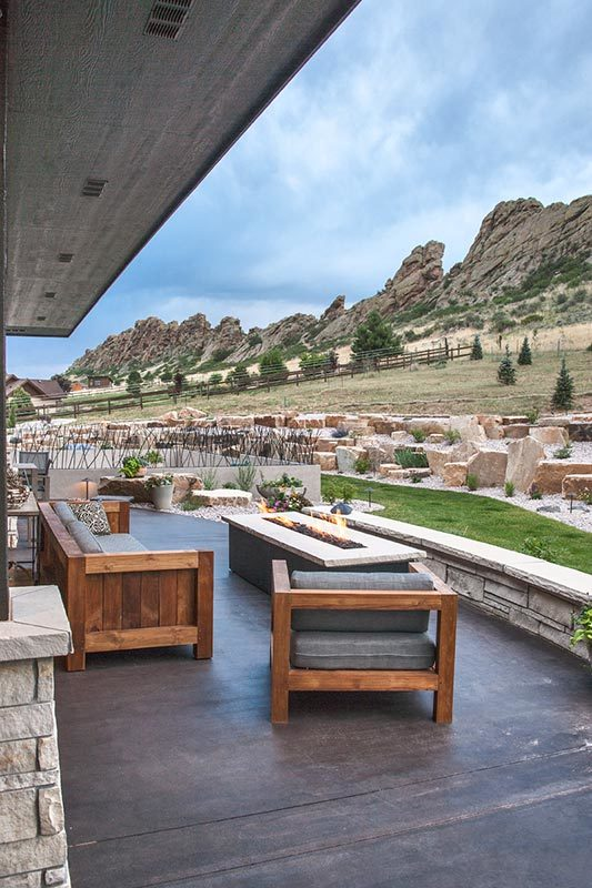 The covered lanai has a fire pit seating overlooking the magnificent surrounding.