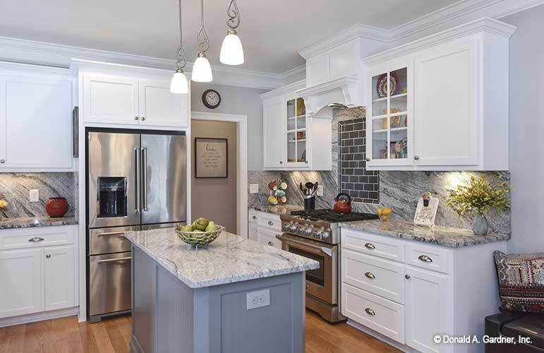 One last look at the kitchen with white cabinets and elegant granite countertops.