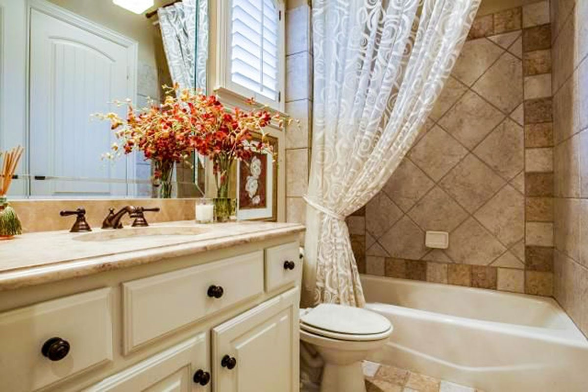 This bathroom is similar to the previous bath complete with a sink vanity, toilet, and a shower and tub combo.This bathroom is similar to the previous bath complete with a sink vanity, toilet, and a shower and tub combo.