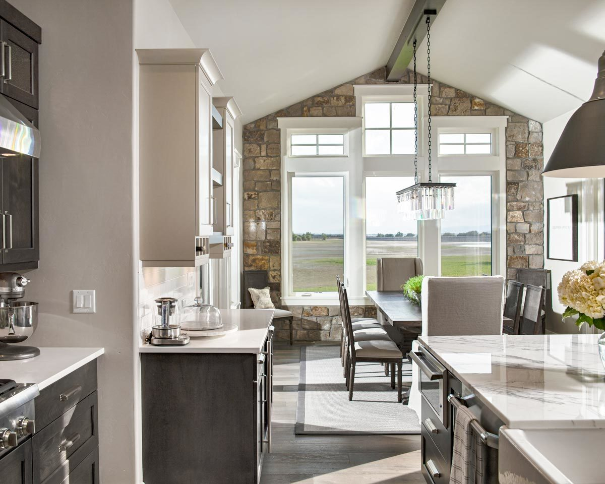Triple pane windows by the dining area provide an expansive view.