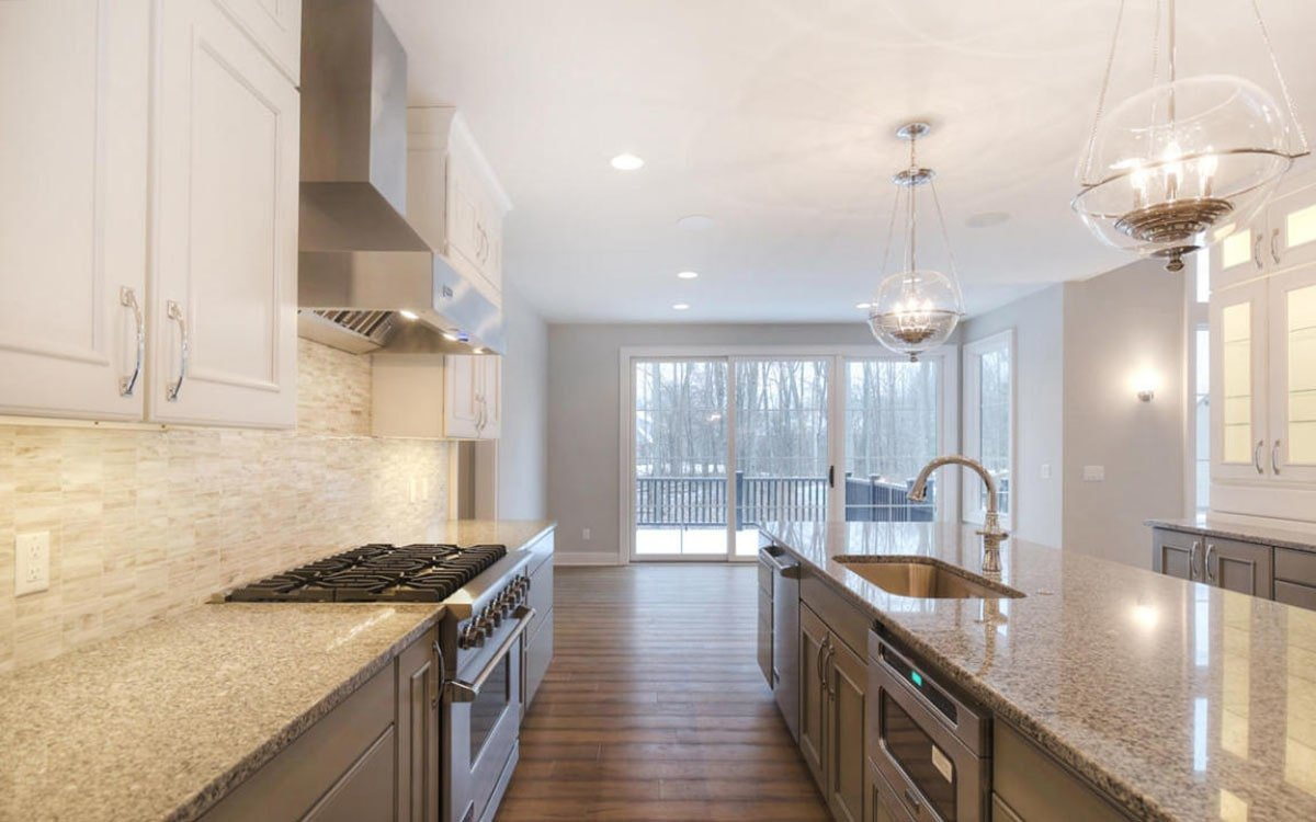 The kitchen offers lots of counter space, stainless steel appliances, and an undermount sink fitted on the central island.
