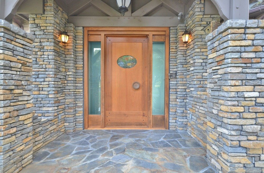 This is a focused look at the house's main entry featuring attractive stone walls. Images courtesy of Toptenrealestatedeals.com.