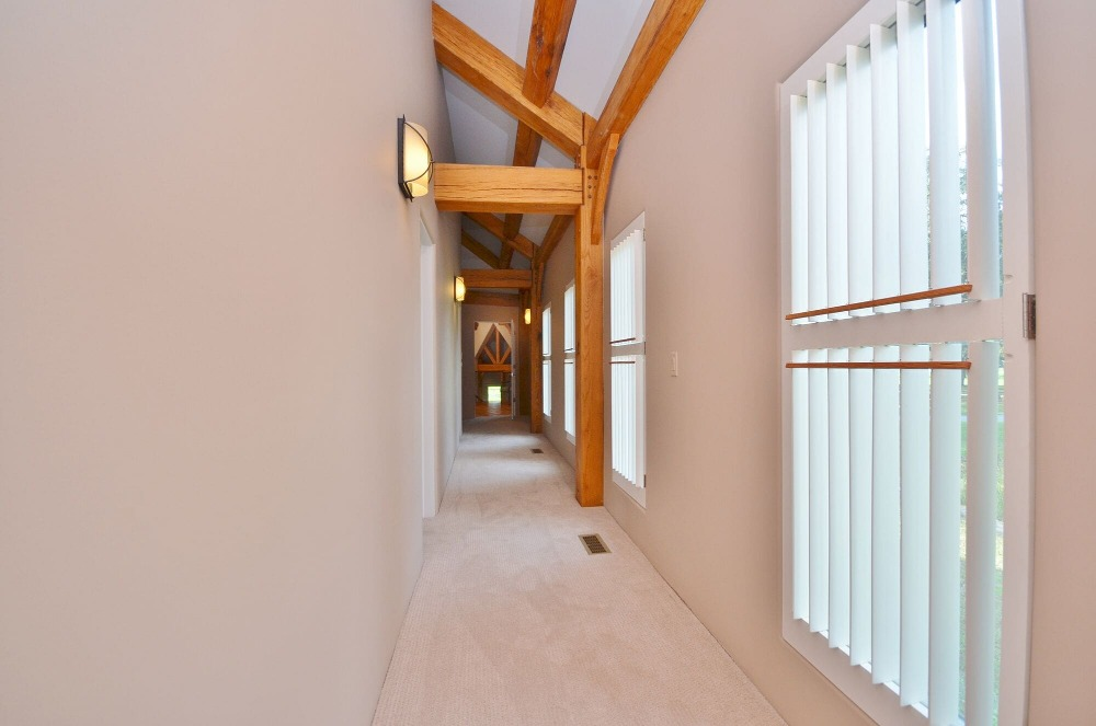 This hallway features a shed ceiling with exposed beams and has carpeted flooring. Images courtesy of Toptenrealestatedeals.com.