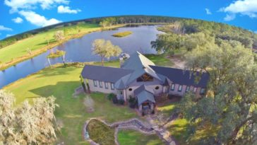 This aerial view focuses on the house's exterior and the stunning natural landscape surrounding it. Images courtesy of Toptenrealestatedeals.com.