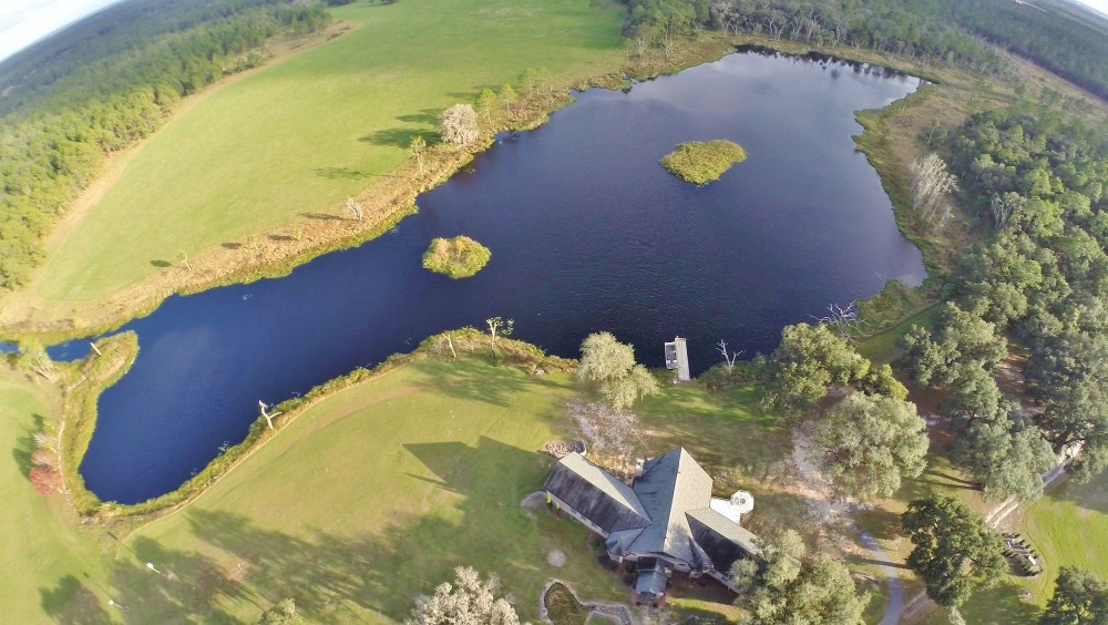 Aerial view of the property boasting the lake and the wide lawn areas. Images courtesy of Toptenrealestatedeals.com.
