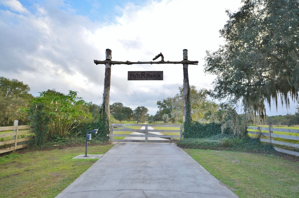 Here's the entrance to the ranch with a nice sign and wooden gate. Images courtesy of Toptenrealestatedeals.com.