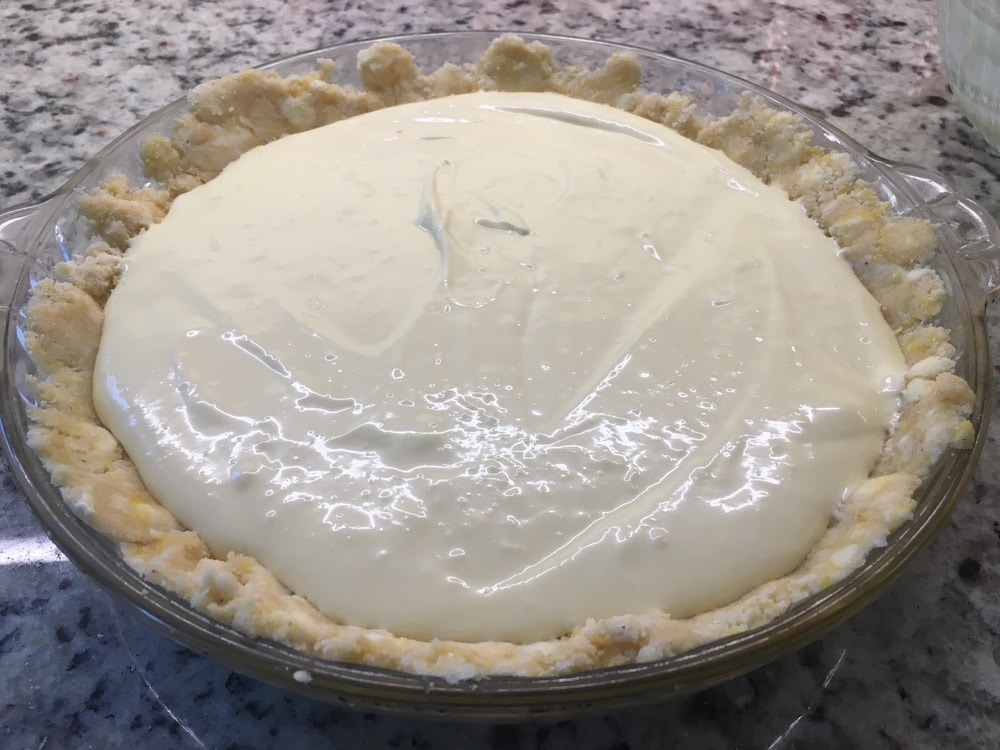 The filling placed on the crust.
