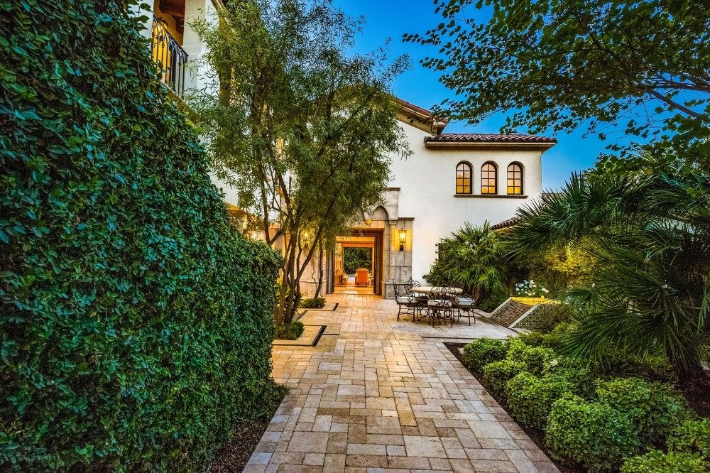 There's a beautiful walkway outside surrounded by the home's lush greenery. Images courtesy of Toptenrealestatedeals.com.