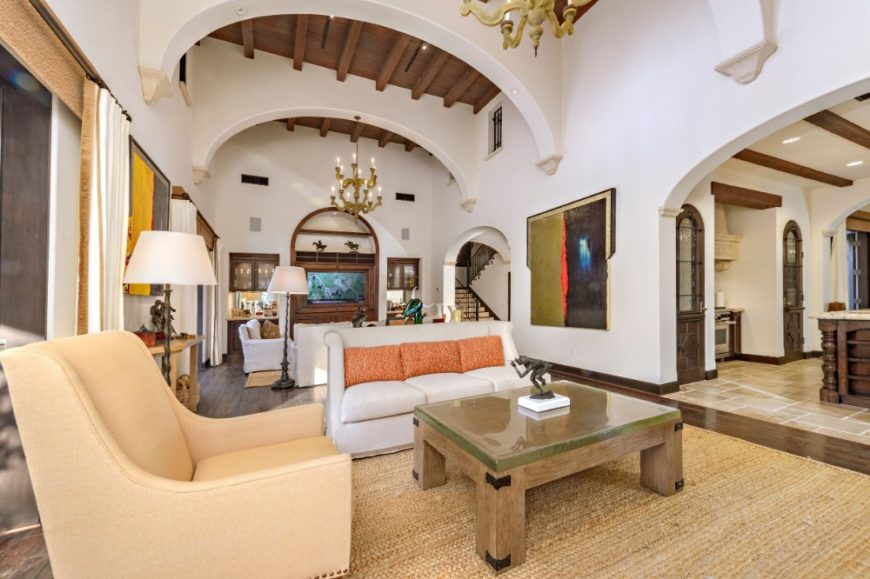 Large living room with two sets of living space set under the home's tall ceiling. Images courtesy of Toptenrealestatedeals.com.