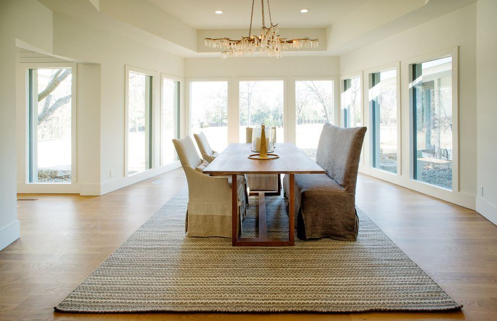 This other view of the dining room shows the gorgeous row of tall glass windows that bring in an abundance of natural lighting to the beige walls and beige tray ceiling. Images courtesy of Toptenrealestatedeals.com.