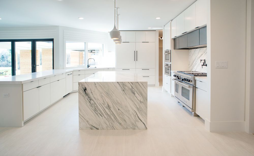 This is the bright and white kitchen that showcases its gorgeous white marble kitchen island topped with white pendant lights across from the cooking area. Images courtesy of Toptenrealestatedeals.com.