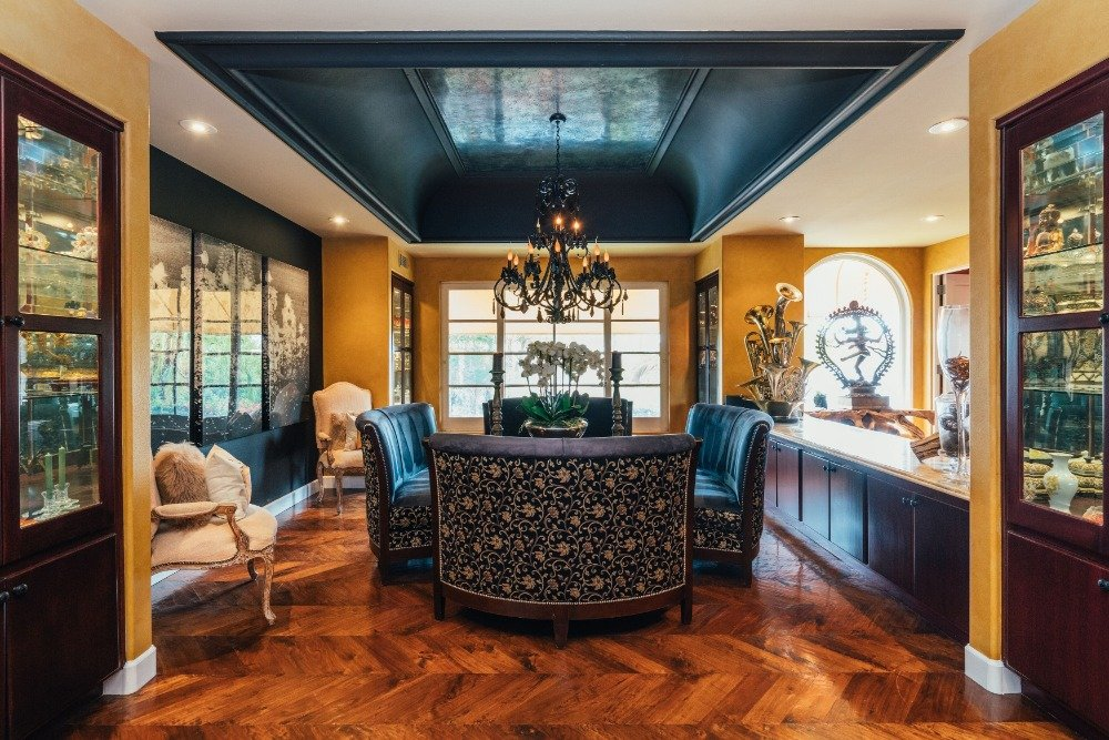 Formal living space with a set of elegant seats lighted by a stunning black chandelier. Images courtesy of Toptenrealestatedeals.com.