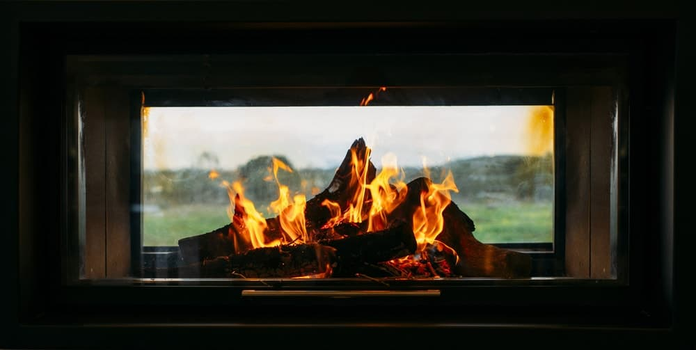 A close-up of a fireplace seen through clean and clear glass covers.