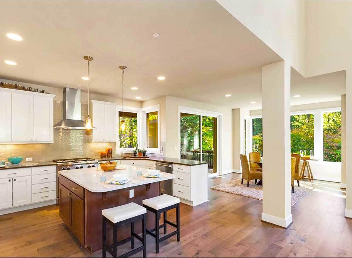 An open kitchen defined with interior columns and a low regular ceiling.