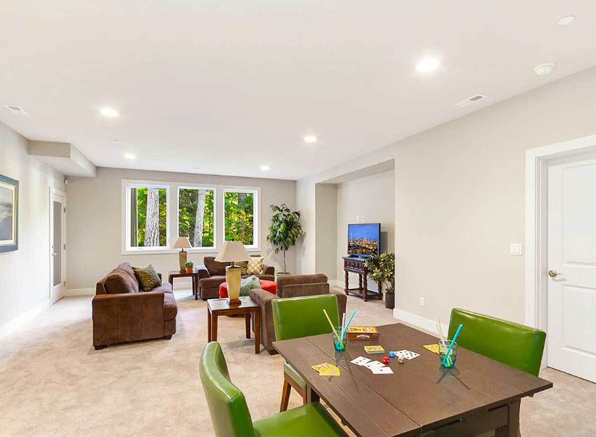 An enormous recreation room offering multiple seating and a flat-screen TV.