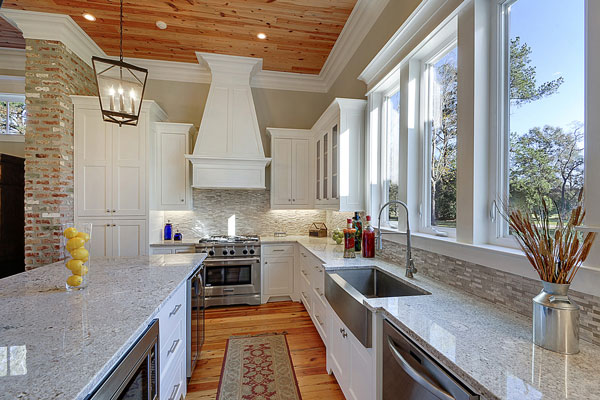 The kitchen also offers a farmhouse sink situated under the three-pane windows overlooking the outdoor scenery.