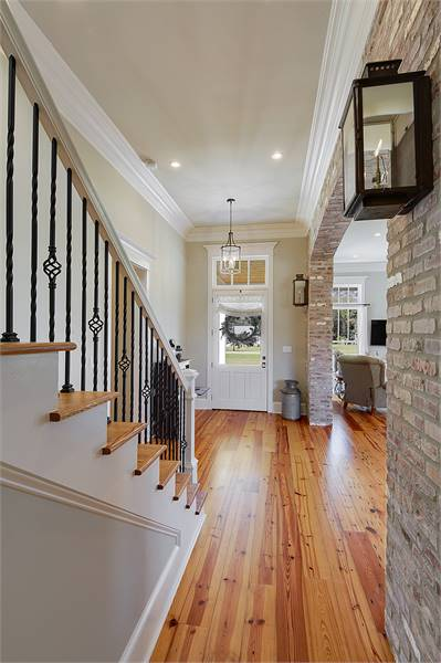 A hallway next to the staircase that leads to the mudroom.