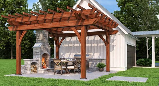 A closer look at the separate garage with outdoor dining, summer kitchen, and a stone fireplace enclosed in a wooden pergola.