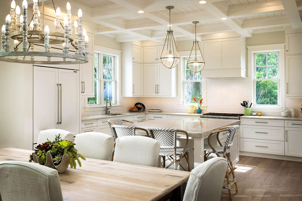 The kitchen has a coffered ceiling and slim windows that invite natural light in.