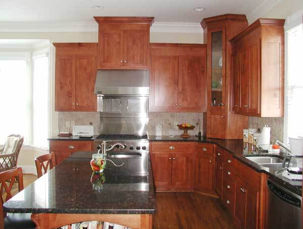 The kitchen is equipped with undermount sinks, stainless steel appliances, and wooden cabinetry.
