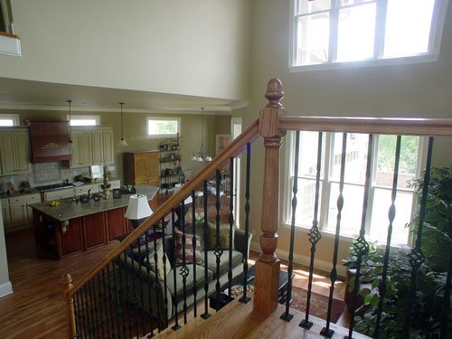 An open layout view from the staircase showing the family room and kitchen.