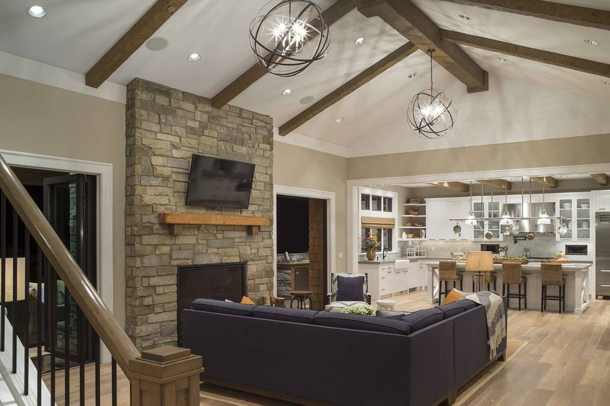 A high cathedral ceiling lined framed with rustic wood beams crown the living room.