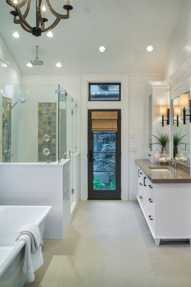 The master bathroom is equipped with a deep soaking tub, a walk-in shower, and sink vanity.