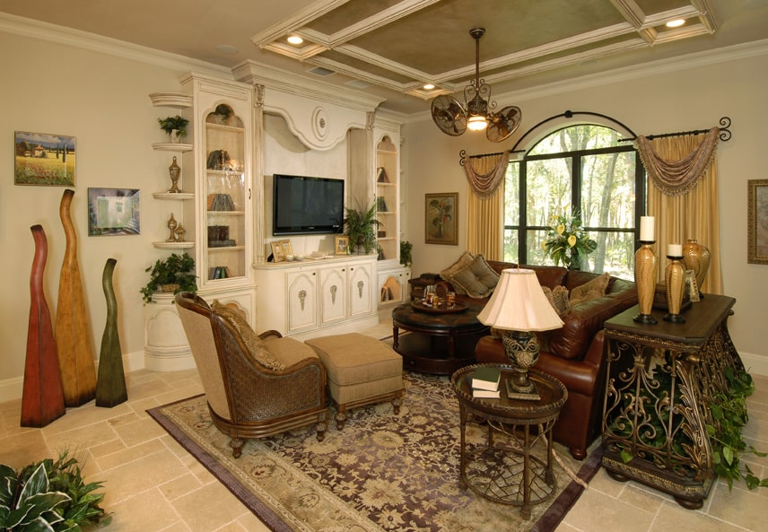 A wall-mounted TV and an ornate lighting fixture hanging from the stylish ceiling complete the living room.