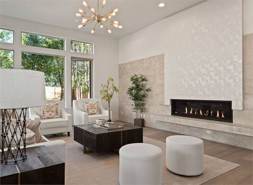 There's also a sputnik chandelier and a modern fireplace that's fixed against the marble brick wall.