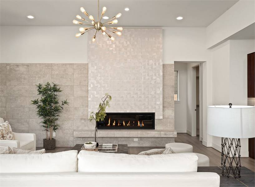A gorgeous white tiled panel creates a stunning accent to the marble brick wall.