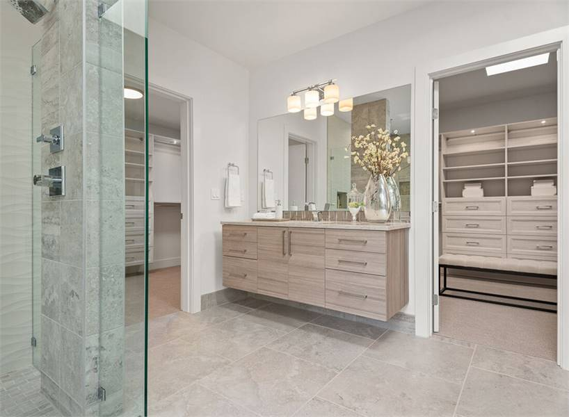 This corner vanity is nestled in between his and her walk-in closets.