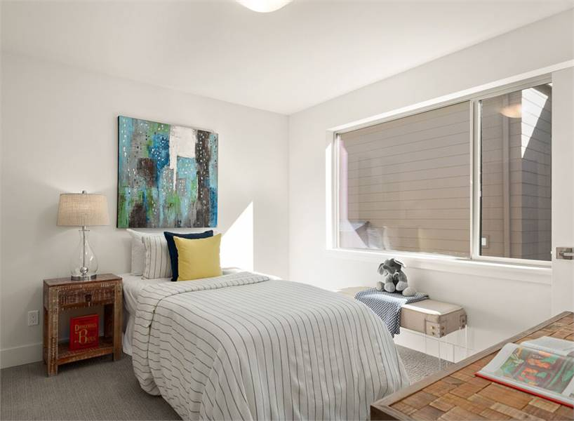 Another bedroom with a glass sliding window and white walls adorned with an abstract painting.
